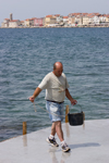Slovenia - Piran: getting a bucket of sea water - photo by I.Middleton