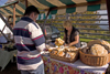 Slovenia - Jance: woman selling local produce at the Chestnut Sunday festival - photo by I.Middleton