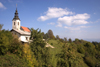 Slovenia - Jance: hilltop church and clouds - photo by I.Middleton