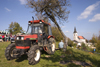 Slovenia - Jance: tractor and church - Chestnut Sunday festival - photo by I.Middleton