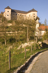 Slovenia - Kostel - road and Kostel castle - photo by I.Middleton