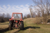 Slovenia - Pivka Valley: farmer driving tractor - Karst region - photo by I.Middleton
