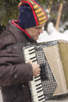 accordion - musician busking at Planica ski jumping championships, Letalnica, Slovenia - photo by I.Middleton