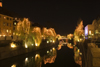 Christmas illuminations reflected on the river Ljubljanica, Ljubljana , Slovenia - photo by I.Middleton