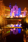 river Ljubljanica and the Franciscan church at night - Christmas lights, Ljubljana , Slovenia - photo by I.Middleton