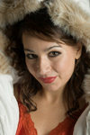 Young woman in a glamorous fashion pose wearing a winter parka with fur lined hood creative, lifestyle, portrait - photo by D.Smith