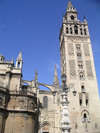 Sevilla, Andalucia, Spain / España: the Giralda, built as an Almohad minaret and the Cathedral - photo by R.Wallace