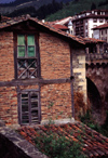 Spain - Cantabria - Potes - red brick building - photo by F.Rigaud