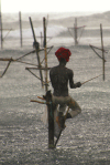 Weligama, Southern Province, Sri Lanka: stilt fisherman in the rain - photo by B.Cain