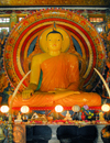 Colombo, Sri Lanka: Gangaramaya Temple - sitting Buddha and tusks - Slave island - photo by M.Torres