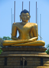 Colombo, Sri Lanka: Gangaramaya Temple - golden Buddha sitting - Slave island - photo by M.Torres