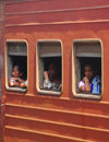 Colombo, Sri Lanka: passengers on a 3rd class carriage - train at Colombo Fort Railway Station - photo by M.Torres