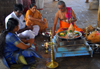 Galle, Southern Province, Sri Lanka: Hindu temple - Brahmin and family during a religious ceremony - puja - photo by M.Torres