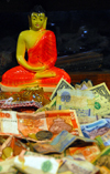 Kandy, Central province, Sri Lanka: Buddha, rupees and dollars - Sri Dalada Maligawa - Temple of the Sacred Tooth Relic - photo by M.Torres