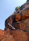 Sigiriya, Central Province, Sri Lanka: tourists on the stairs above the Lion Gate - Unesco World Heritage site - photo by M.Torres