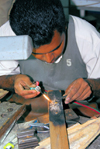 Getambe, Central province, Sri Lanka: precision welder - jewellery factory - photo by M.Torres