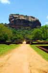 Sigiriya, Central Province, Sri Lanka: walking to the Lion rock - the magma plug from an ancient volcano - Unesco World Heritage site - photo by M.Torres