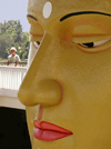 Matara, Southern province, Sri Lanka: temple - Buddha face close-up with tourist - photo by B.Cain