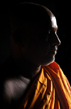 Sri Lanka - Colombo: Sri-Lankan Buddhist Monk in shadow - saffron robe - photo by B.Cain