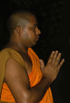 Kandy, Central Province, Sri Lanka: Bhikkhu - praying monk, Temple of the Tooth, Kandy - photo by B.Cain
