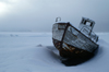 Svalbard - Spitsbergen island - Van Mijenfjorden: old boat in the snow - prow - photo by A. Ferrari