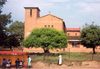 Swaziland - Manzini: red brick church and bus stop - photo by Miguel Torres