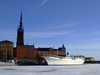 Stockholm, Sweden: Riddarholmen and boat seen from the ice - photo by M.Bergsma