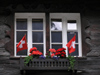 Switzerland - Zermatt, Valais canton: patriotic window - Swiss flags - photo by J.Kaman