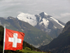 Switzerland - Bernese Alps - Swiss flag against the mountains - Drapeau de la Suisse et montagnes - Flagge der Schweiz - photo by J.Kaman