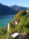 Ringgenberg, district of Interlaken, Berner Oberland, Switzerland: view from above on coffee shop table next to Brienz lake with mountains on the background - photo by E.Keren