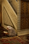 Damascus: Omayyad Mosque - muslim man praying beside minbar (photographer: John Wreford)
