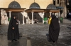 Damascus: muslim tourists photograph each other (photographer: John Wreford)
