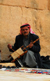 Palmyra / Tadmor, Homs governorate, Syria:playing a Bedouin Rabab, a spike fiddle with quadrilateral sound box covered with skin and a single horsehair string - played with a horsehair bow - Rababah - photo by M.Torres / Travel-Images.com