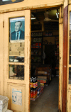 Damascus, Syria - Souq Midhat Basha - grocery door with Hafez al-Assad - photo by M.Torres / Travel-Images.com