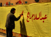 Damascus, Syria: painting slogans for a living - banner - arabic script - photographer: M.Torres