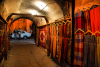 Damascus, Syria: carpets and clothes for sale - a passage at night - old town - photographer: M.Torres