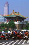 Taiwan - Taipei city - gate and scooters - photo by Bob Henry