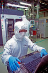 Taiwan - semiconductor manufacturing and silicon foundry - worker operates a computer in a clean room - wafer factory - industry - photo by Bob Henry