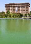 Dushanbe, Tajikistan: Ministry of Foreign Affairs of Tajikistan seen from the pond on Flag Park - photo by M.Torres