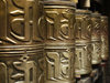Tibet - Lhasa: Jokhang Temple - prayer wheels - embossed hollow metal cylinders containing a scroll printed with a mantra - photo by M.Samper