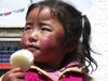 Tibet - Lhasa: girl with sweet - photo by M.Samper