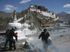 Tibet - Lhasa: Potala palace, stupas, pilgrimns and ritual fire - photo by M.Samper
