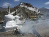 Tibet - Lhasa: Potala palace, stupas and ritual fire - photo by M.Samper