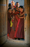 Tibet - childish novices on a door - photo by Y.Xu