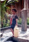 Manatuto: bringing home the water - child with jerrycan