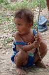 East Timor - Manatuto: toddler hoisting her sandals (photo by M.Sturges)