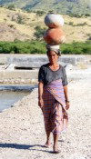 East Timor - Woman in abandoned salt fields with water jugs (photo by M.Sturges)