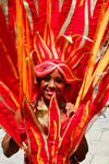 Port of Spain, Trinidad and Tobago: girl with flaming red costume during the carnival parade - photo by E.Petitalot