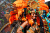 Port of Spain, Trinidad and Tobago: smiling woman in a very colorful costume at the carnaval parade - photo by E.Petitalot