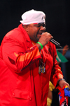 Port of Spain, Trinidad and Tobago: fat man is singing during the carnival - rapper - photo by E.Petitalot